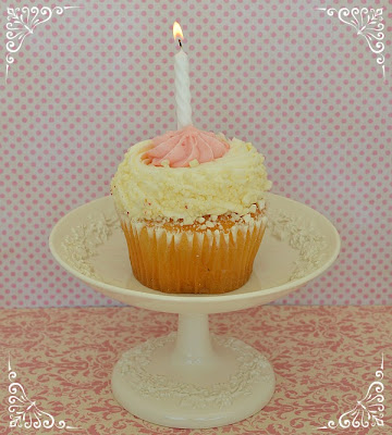 pretty cupcake with candle and pink background