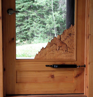 cedar screen door, hand carved wolf howling,  built by john huisman, ely, mn