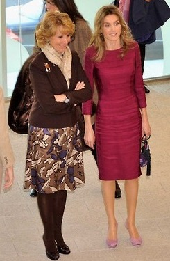 "Queen Letizia today ""recycled"" her infamous plum dress which she wore various times when she was princess; it is most famous for the picture in the middle, when she wore it during the French state visit to Spain in 2010."