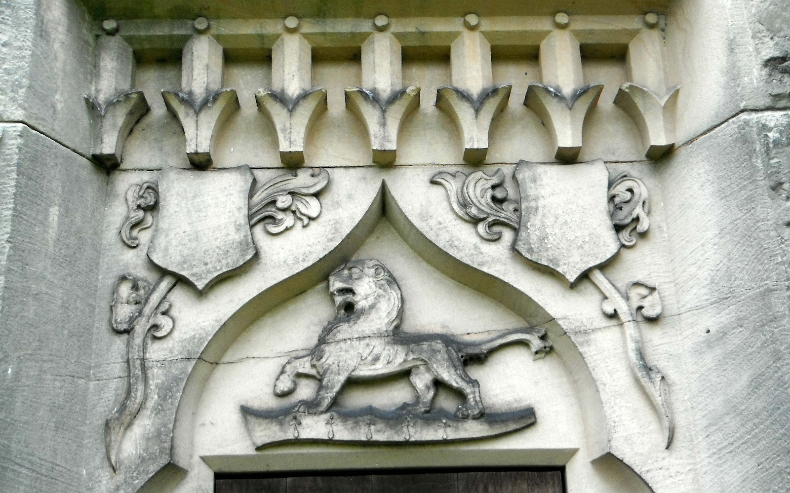 Lion carving at St James The Great Church in Salt