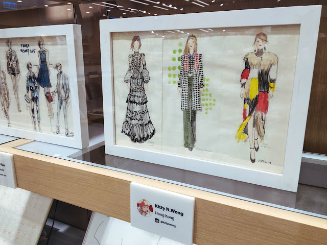 Kitty N. Wong fashion illustration framed on bookshelf