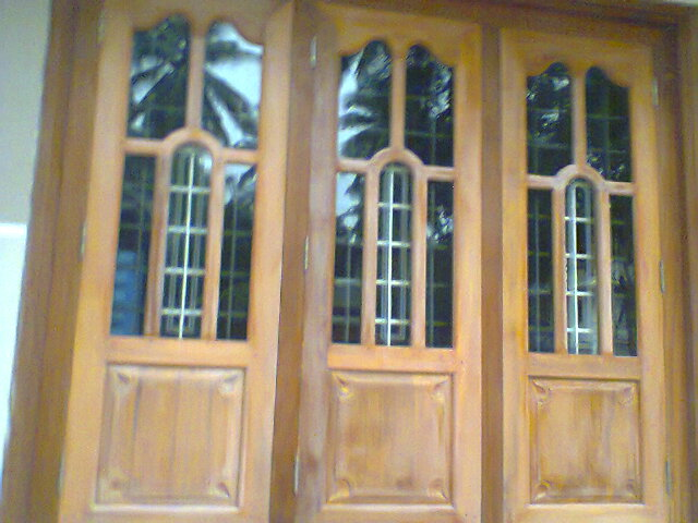 Kerala style carpenter works and designs wooden window for Door and window design