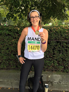 Mandi Brooks with my medal at the Cardiff Half Marathon