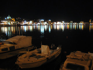 The lights reflecting off the water in Mytilene Harbor on Lesbos, Greece.