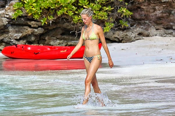 Karolina Kurkova makes a splash in a green bikini around St. Barts on Monday, April 14, 2014.