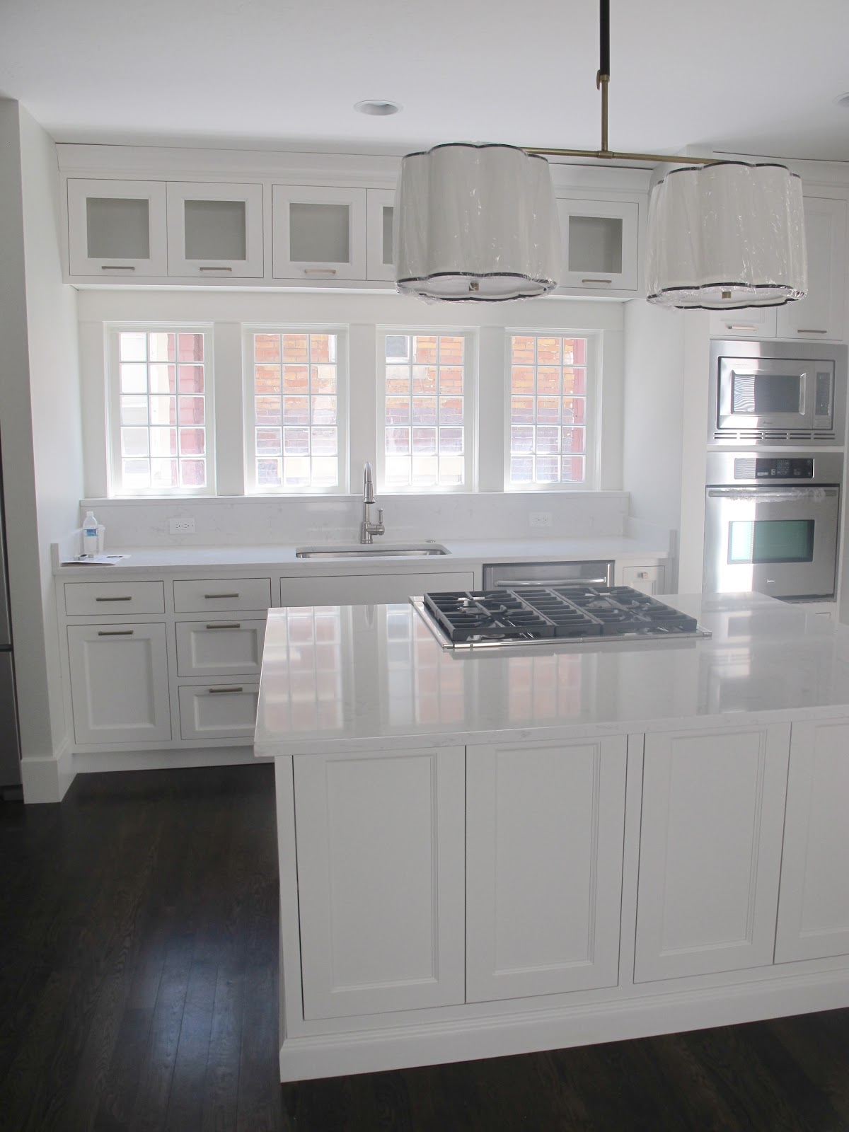 White gold before afters c street project ii for White kitchen with white quartz countertops
