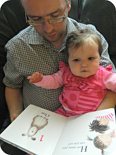 Man and baby girl reading Zoe & Beans: How Many Pets