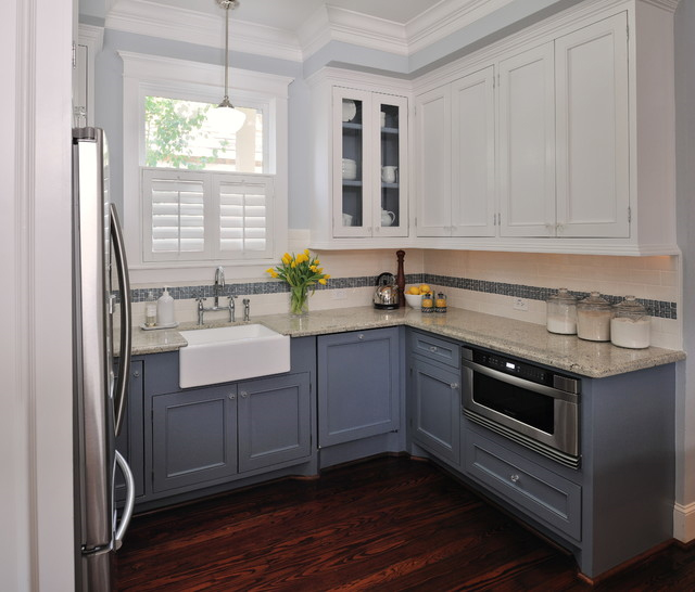 , blonde wood cabinets unite effortlessly with painted teal cabinets