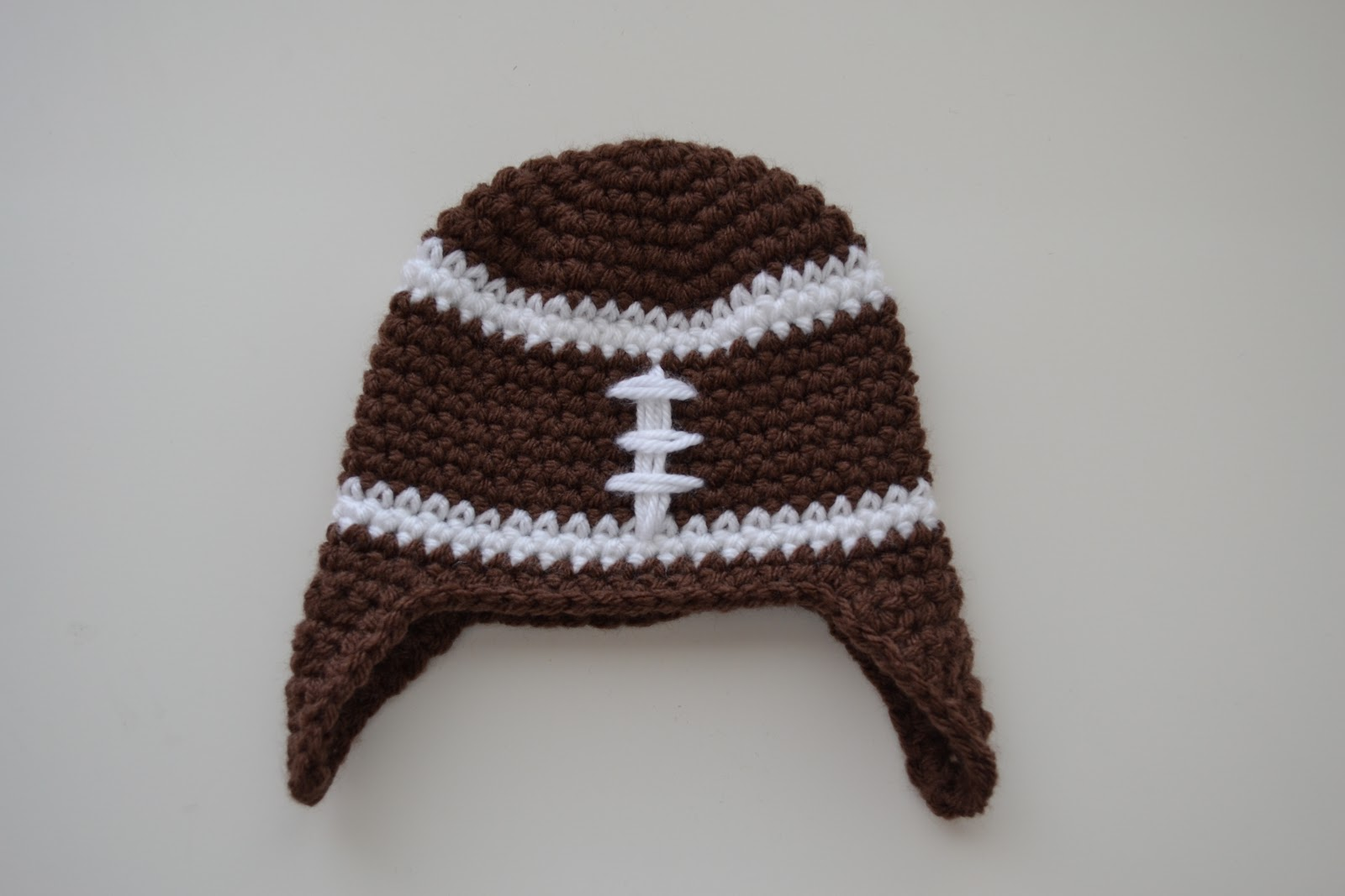 Baby boy football hat crochet pattern manet for all things bright and beautiful crochet newborn football baby boy football hat crochet pattern bankloansurffo Choice Image