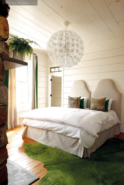 This could be a cute DIY idea, using 2 twin headboards to make a kind size headboard.