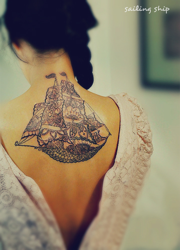 A very unique sailing ship tattoo with lace style.