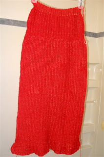 front of my bright red Christmas dress clipped to a hanger