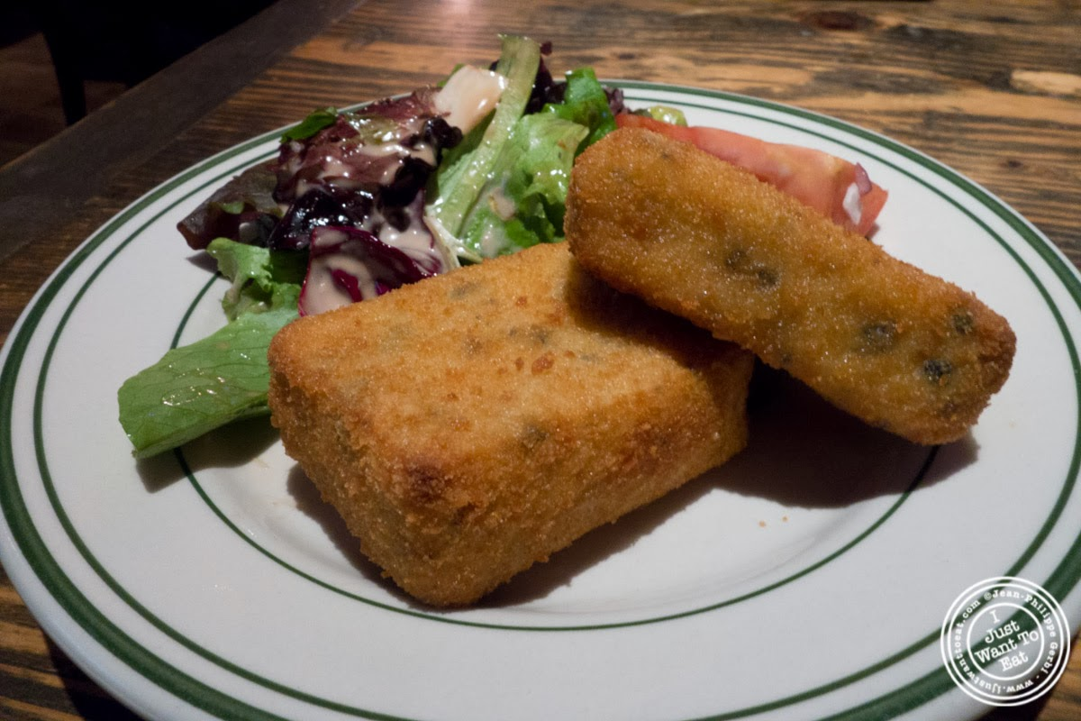 image of croquettes aux truffes  at BXL Café in the Theater District, NYC, New York