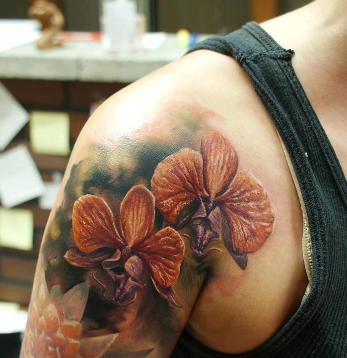 See more 3D blossoming flower tattoos on shoulder and arm