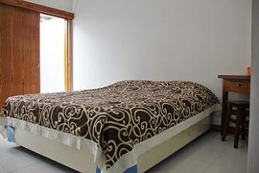 Kamar Deluxe Prima Dini Hotel  Bukittinggi