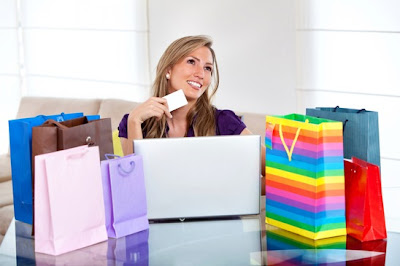 Woman thinking purchasing clothes online
