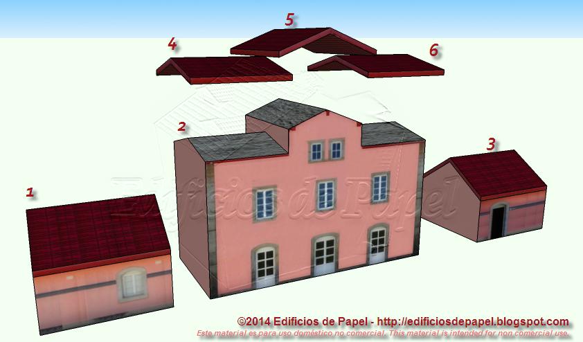 Distintas piezas para construir la maqueta de papel de la estación de tren