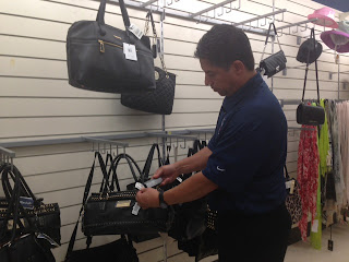 Metoyer checks the electronic tags on merchandise in stores.