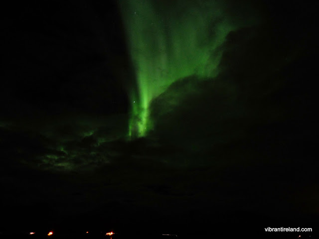 northern lights erupt from cloud, norway
