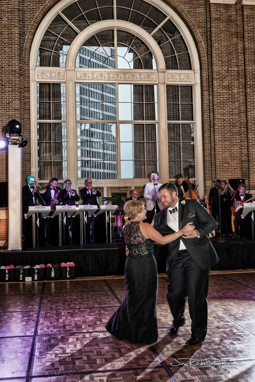 dance with Mom with the huge window backdrop at Union Station Dallas
