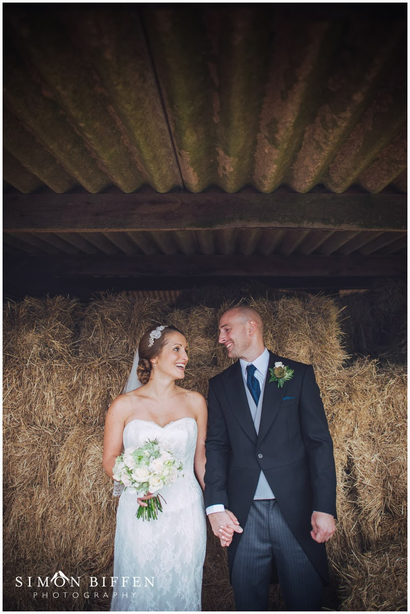 Old Corn Barn Devon wedding bride and groom