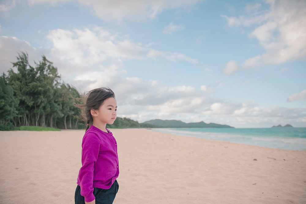 Andrea playing on the beach, northern Oahu, turtle bay