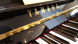 keyboard and fallboard view of Yamaha MX80S Disklavier