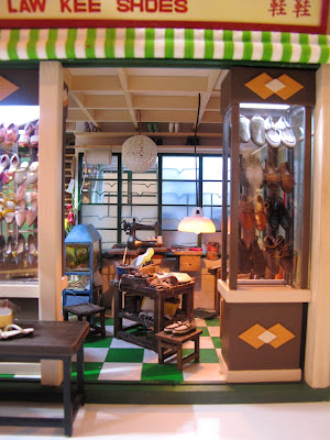 The entrance of a miniature model of a Hong Kong shoe shop from the 1960s.