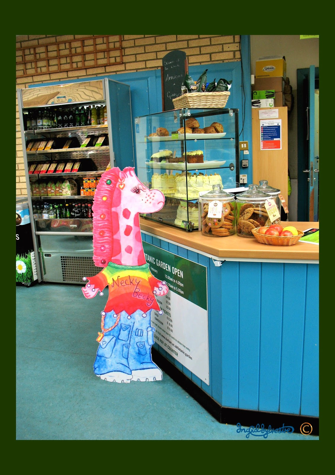 Necky Becky the Giraffe waiting for Cake at the Cafe in the University of Durham Botanic Garden Giraffe Stories and Activities Ingrid Sylvestre Artist & Writer North East UK Storyteller County Durham Newcastle upon Tyne Sunderland Tyne & Wear Middlesbrough Teesside Cleveland Northumberland Yorkshire