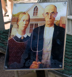 American Gothic two stern figures