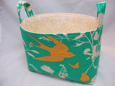 small fabric storage bin with bird image