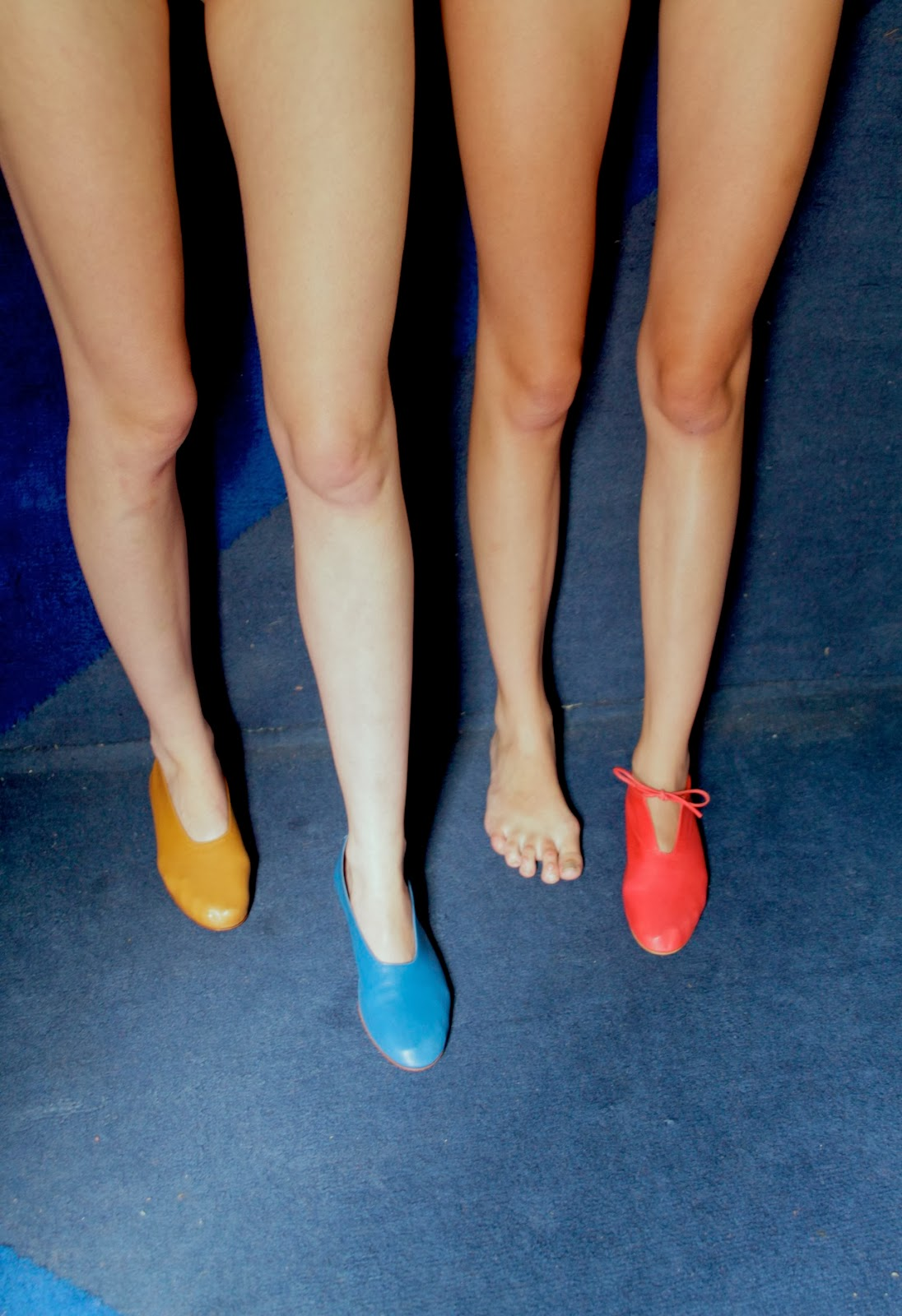 shoes by Martiniano Lopez for MARTINIANO, girls legs in leather slippers, blue background