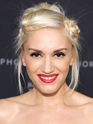 Gwen Stefani stays true to her punk roots with a funky updo complete with framing pieces and twists.