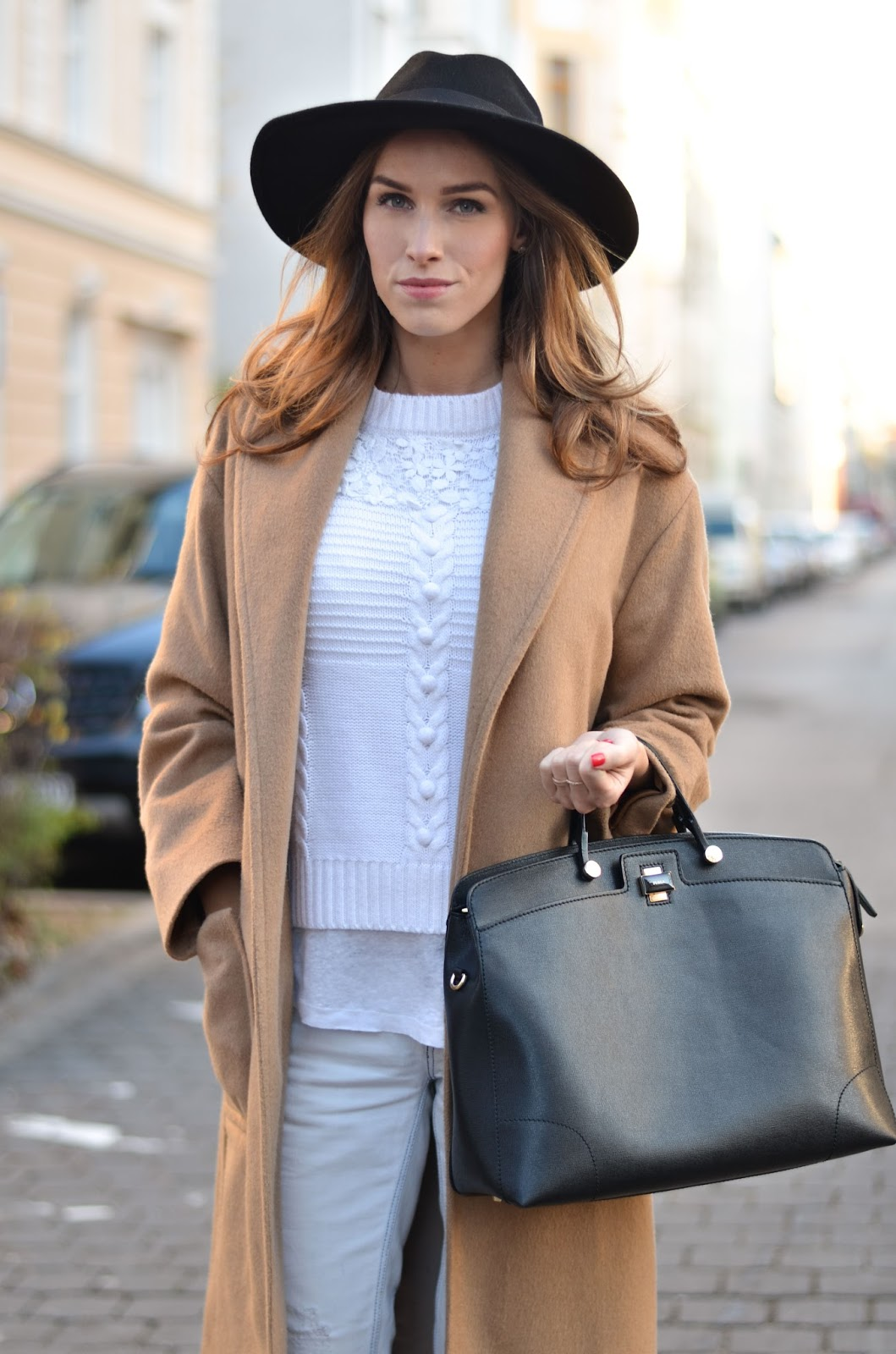 kristjaana mere camel coat black fedora hat white sweater ripped jeans casual winter fashion