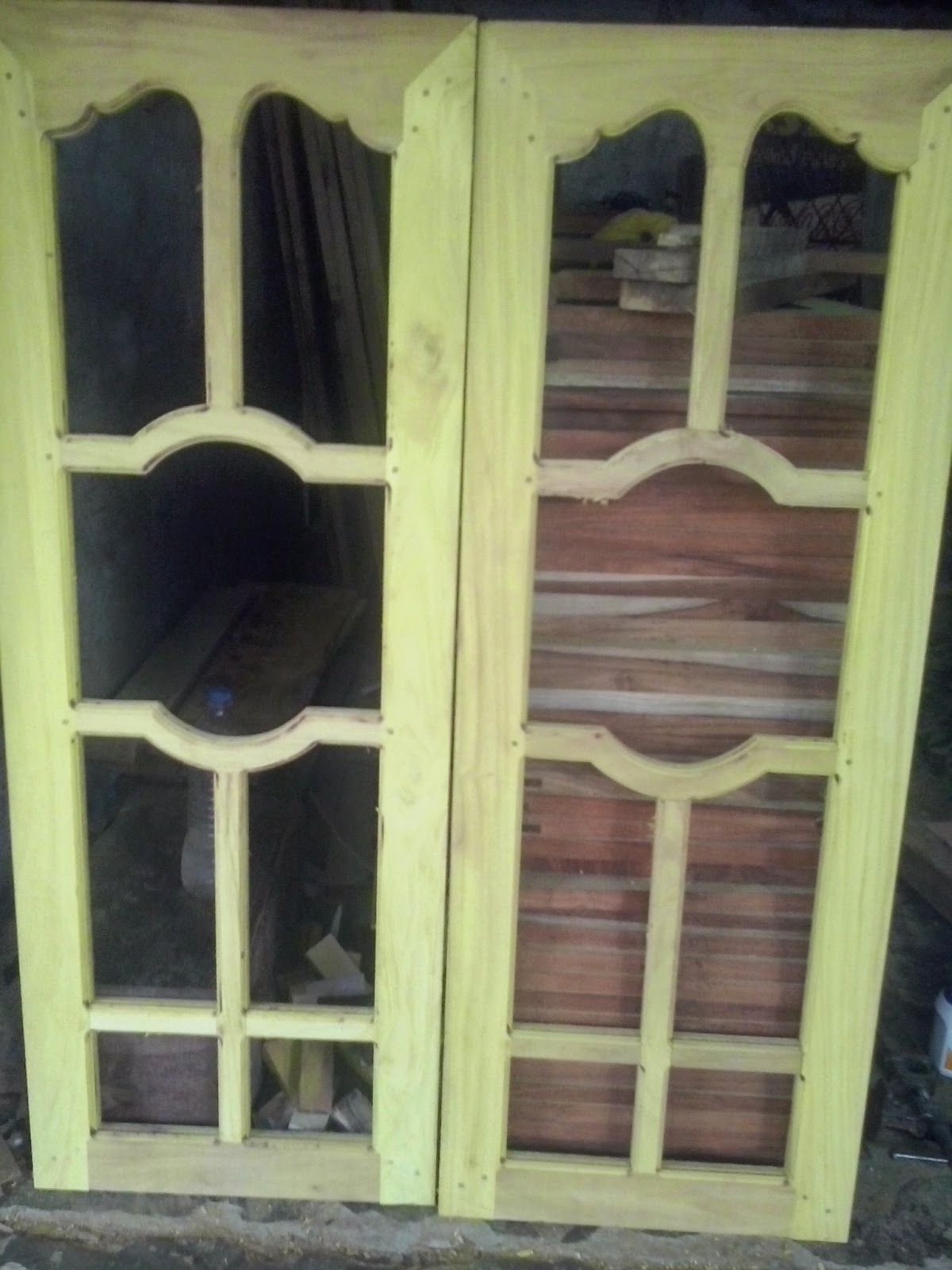 Kerala style carpenter works and designs window door for Wood window door design