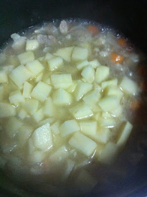 After 5 mins, put 1 1/2 cup water then put the potatoes