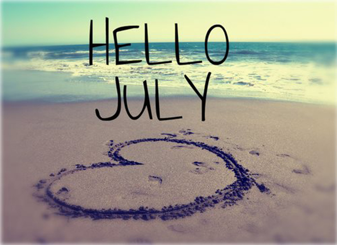 Hello July. Heart drawn in the sand on a beach