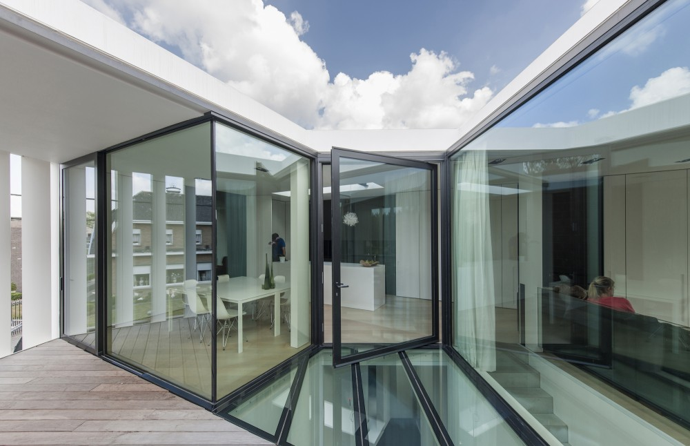 Simplicity love house k belgium graux baeyens architecten - Glazen ingang ...