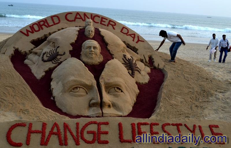 "A sand sculpture on World Cancer day with a message ""Change Lifestyle, Curb Cancer  at Puri beach by sudarsan pattnaik"