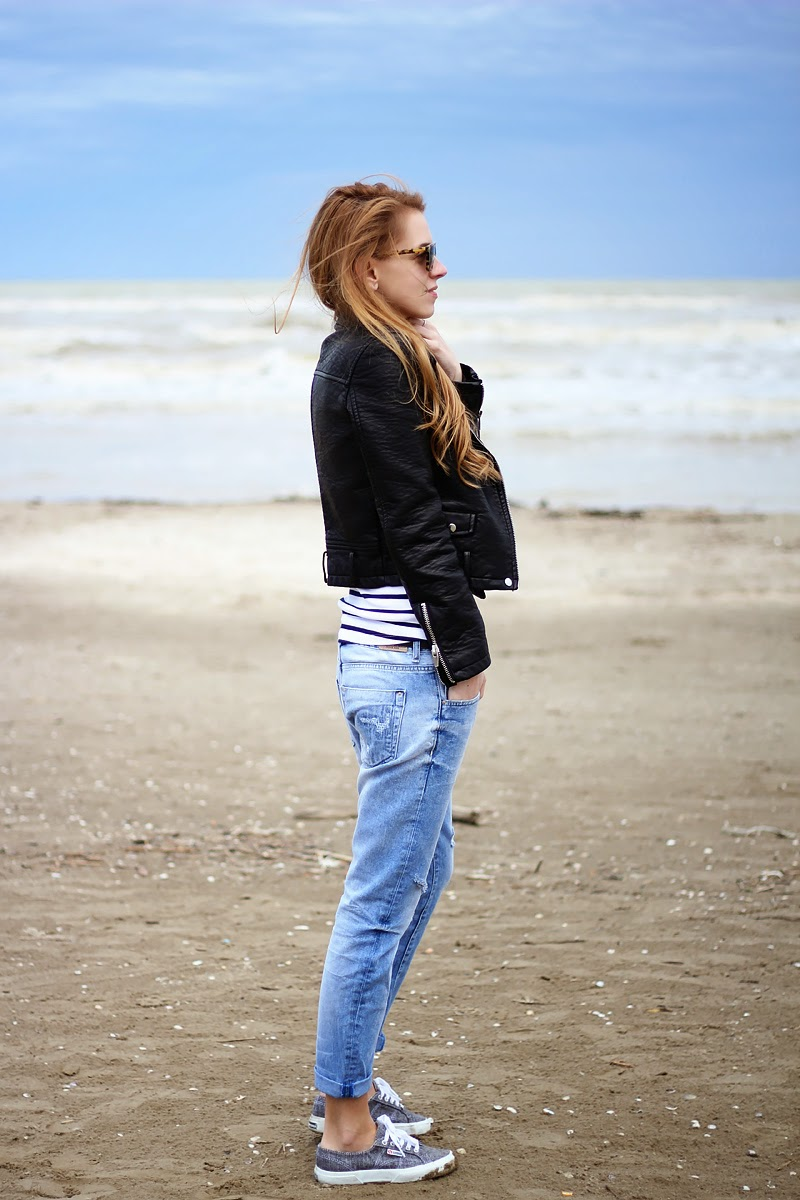 boyfriend jeans, striped top, moto leather jacket, sneakers