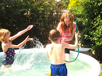 children playing in pool with mum