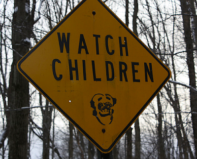 Defaced Signs Seen On www.coolpicturegallery.us