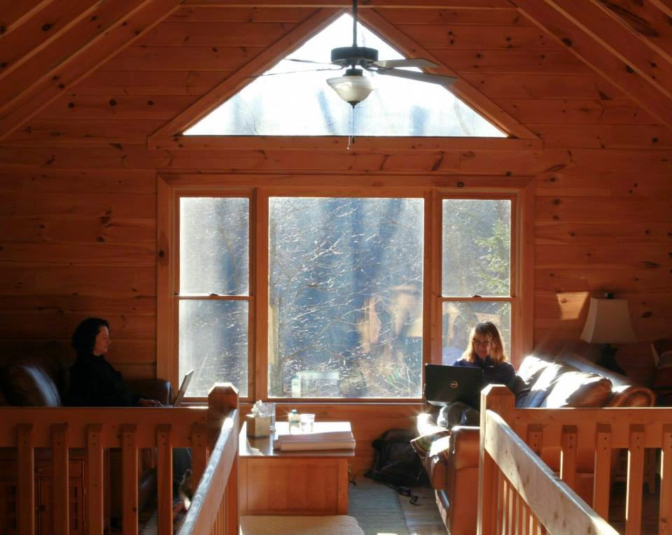 Hanna and Lynne writing in the cabin's loft
