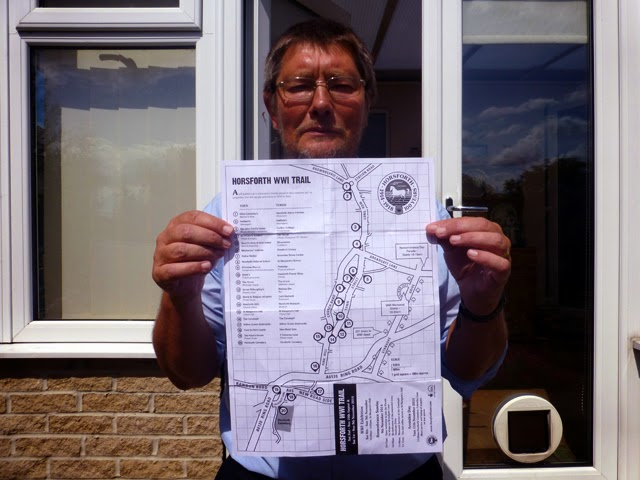 Paul Tasker holding Horsforth WW1 Trail map