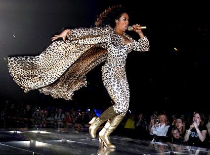 Leopard print jumpsuit and cape.