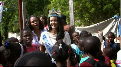 Miss World 2013 Megan Young laughing with the children just moments before the collapse [Photo courtesy of Miss World]