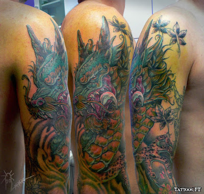 tattoos com Dragao verde no braco