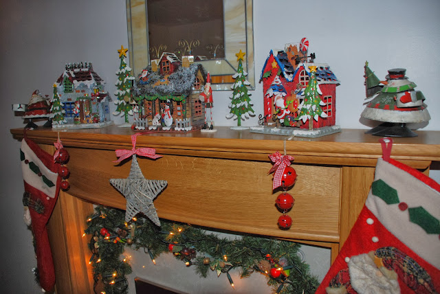 image of christmas decorations on fireplace
