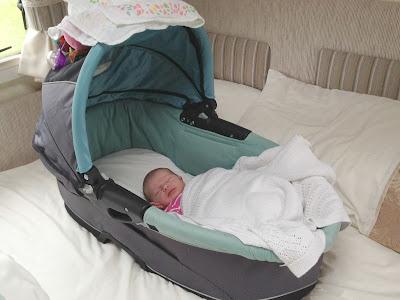 Tin Box Baby sleeping in the caravan