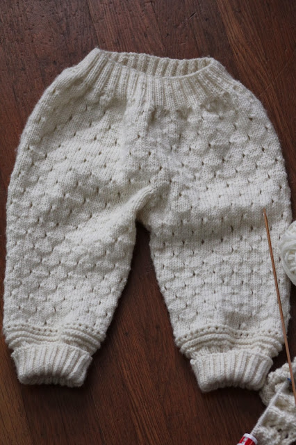 Knitted eyelet baby pants drops design